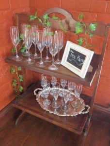 Vintage champagne glasses on tea trolley